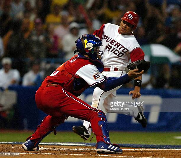 Puerto Rico's Ivan Rodriguez is tagged out at the plate by Cuba's Ariel Pestano in the seventh inning during the World Baseball Classic at Hiram...