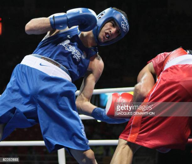 Puerto Rico's Jose Pedraza fights against Turkey's Onur Sipal during their 2008 Olympic Games Lightweight boxing bout on August 11 2008 in Beijing...