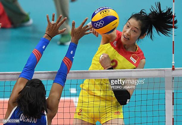 Puerto Rico's Karina Ocasio Clemente vies with China's Zhu Ting during the women's qualifying volleyball match between China and Puerto Rico at the...