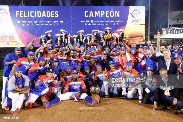 Puerto Rico's Luis Matos of Criollos de Caguas celebrate with the trophy after the final of Caribbean Baseball Serie at the Charros Jalisco stadium...