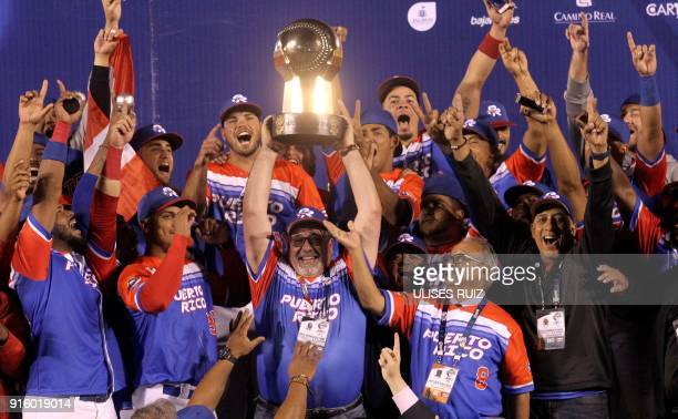 TOPSHOT Puerto Rico's Luis Matos of Criollos de Caguas celebrate with the trophy after the final of Caribbean Baseball Serie at the Charros Jalisco...
