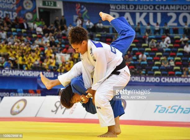 Puerto Rico's Maria Perez fights against Japan's Chizuru Arai in their women's under 70kg category semifinal bout of the 2018 Judo World...