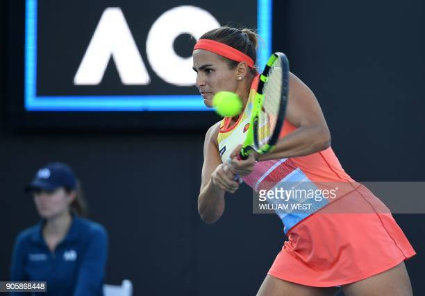 Puerto Rico's Monica Puig plays a backhand return to Estonia's Kaia Kanepi during their women's singles second round match on day three of the...