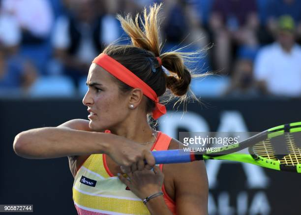 Puerto Rico's Monica Puig plays a forehand return to Estonia's Kaia Kanepi during their women's singles second round match on day three of the...