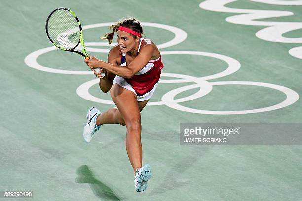 Puerto Rico's Monica Puig returns the ball to Germany's Angelique Kerber during their women's singles finals tennis match at the Olympic Tennis...