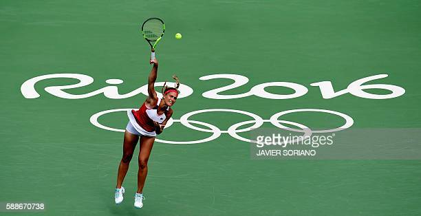 TOPSHOT Puerto Rico's Monica Puig serves the ball to Czech Republic's Petra Kvitova during their women's singles semifinals tennis match at the...