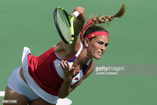 Puerto Rico's Monica Puig serves the ball to Czech Republic's Petra Kvitova during their women's singles semi-finals tennis match at the Olympic...