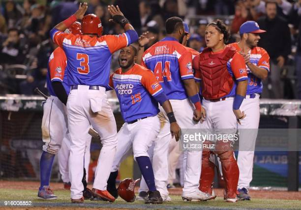 Puerto Rico's players of Criollos de Caguas celebrate their victory over Aguilas Cibaenas of Republica Dominicana during the final of Caribbean...