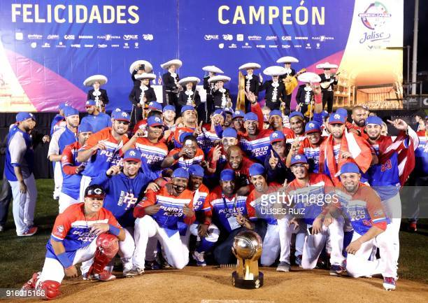 Puerto Rico's players of Criollos de Caguas celebrate with the trophy after the final of the Caribbean Baseball Series at the Charros Jalisco stadium...