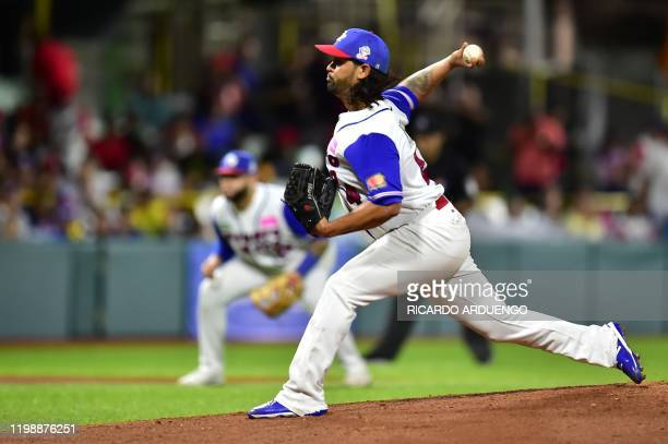 Puerto Rico's starting pitcher Jason Garcia throws to during the first inning of the Caribbean Series baseball tournament against Dominican Republic...
