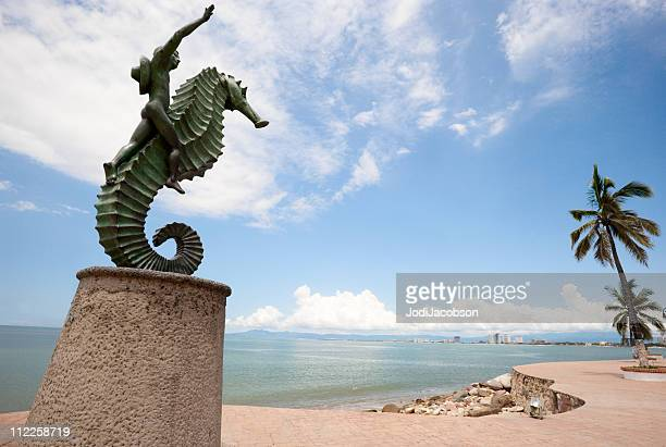 puerto vallarta malecon boy on seahorse - sea horse stock photos and pictures