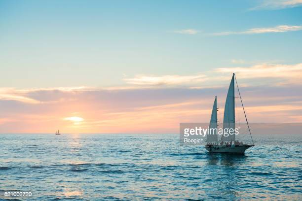 puerto vallarta sailboat in pacific ocean at sunset mexico - boat stock pictures, royalty-free photos & images