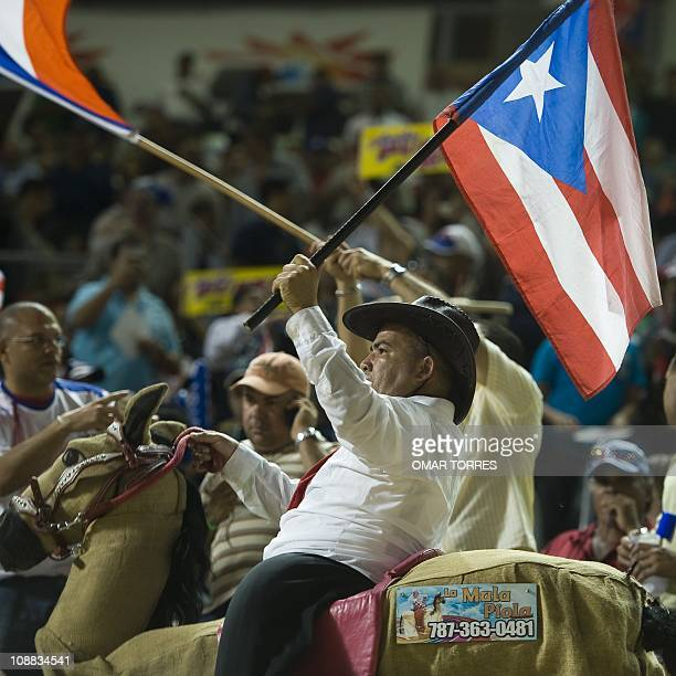 A Puertorican dancer performs with his national flag prior the Caribbean Baseball Series game netween Dominican Republic and Puerto Rico at the...