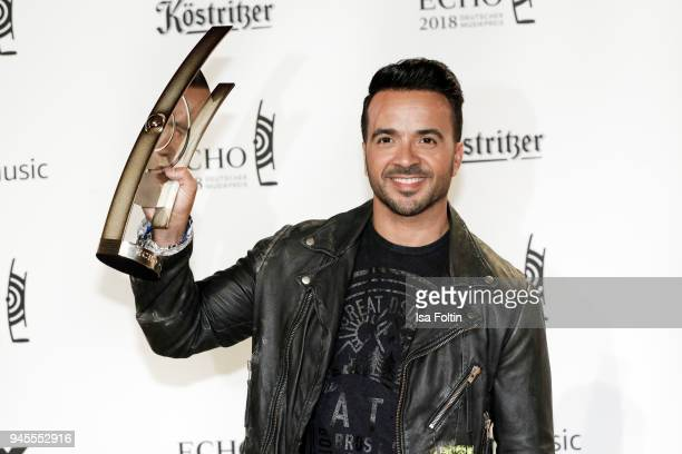 PuertoRican singer and award winner Luis Fonsi poses with award during the Echo Award winners board at Messe Berlin on April 12 2018 in Berlin Germany