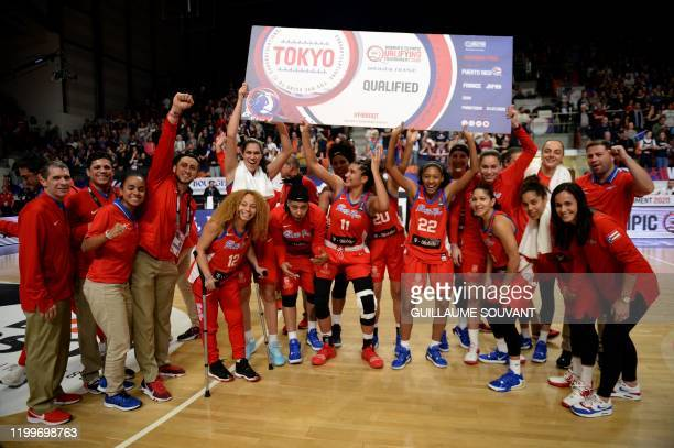 PuertoRico's team celebrate at the end of the FIBA Women's Olympic Qualifying Tournament match between France and Puerto Rico on February 9 at the...