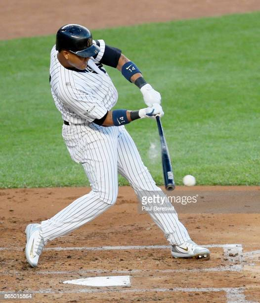 A puff of rosin rises as Starlin Castro of the New York Yankees bats in Game Four of the American League Championship Series against the Houston...
