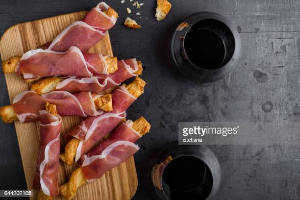 Puff pastry cheese sticks with cured ham