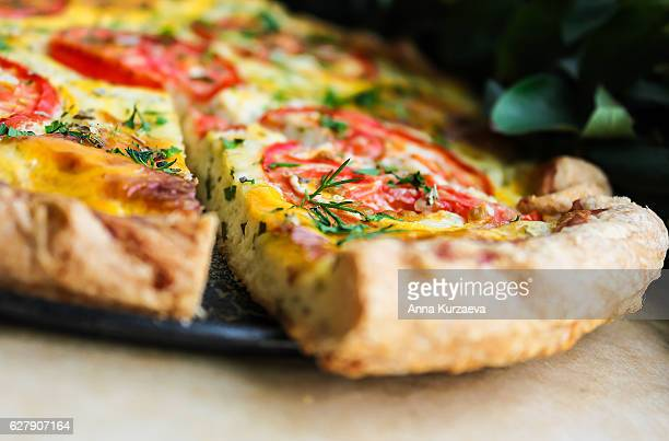Puff pastry pie with cream cheese, tomatoes, dill