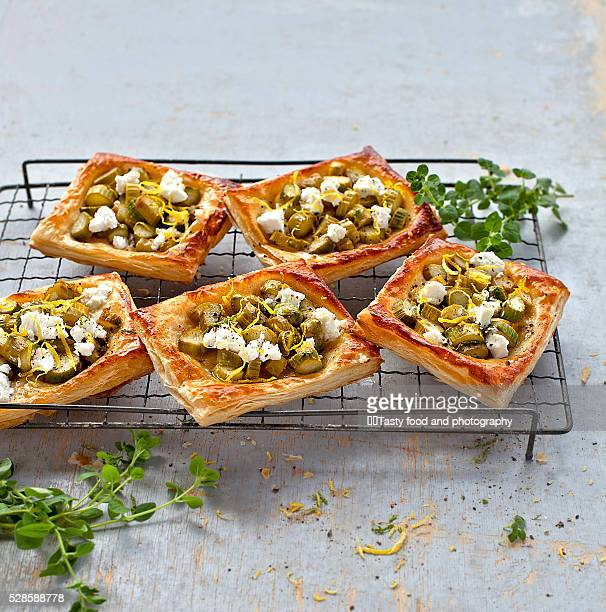 Puff pastry pies stuffed with asparagus and goat cheese.