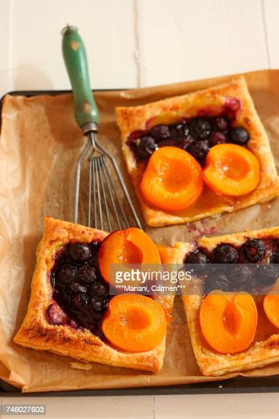 Puff pastry slices with apricots and blueberries