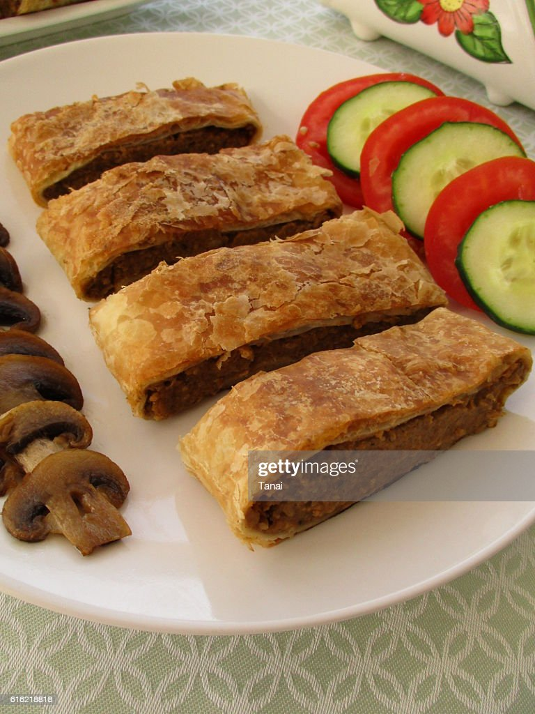 Puff pastry stuffed with eggplant and mushrooms : Stock Photo