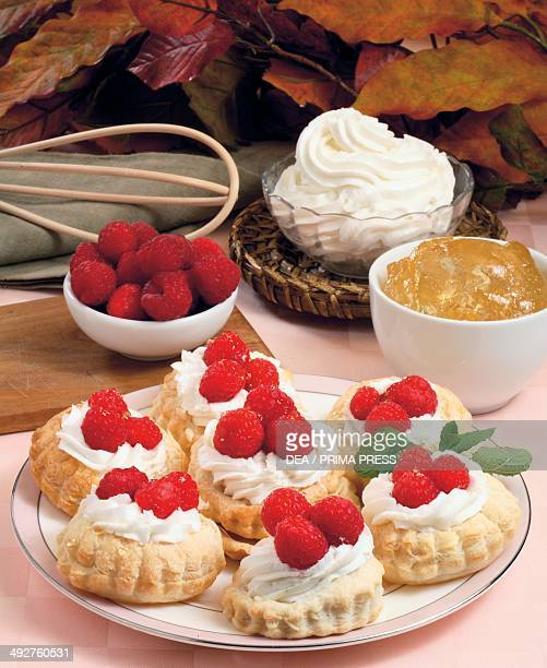 Puff pastry tartlets with whipped cream and raspberries