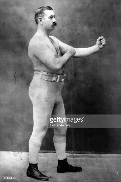 Pugilist John Lawrence Sullivan , the last bare-knuckle heavyweight champion.