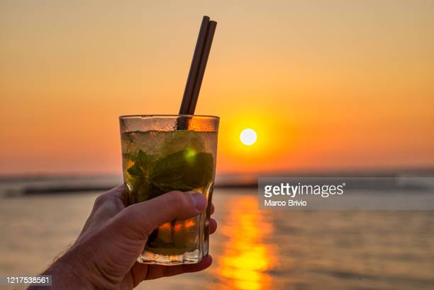 puglia apulia italy. gallipoli. aperitif at sunset on the beach - marco brivio stock pictures, royalty-free photos & images