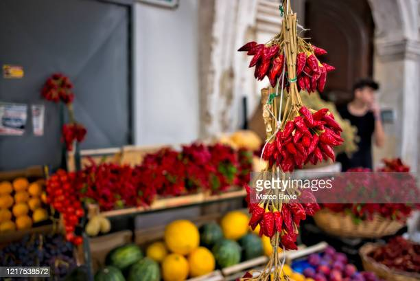 """puglia apulia italy. gallipoli. """"nred chillies on sale from the greengrocer - marco brivio stock pictures, royalty-free photos & images"""