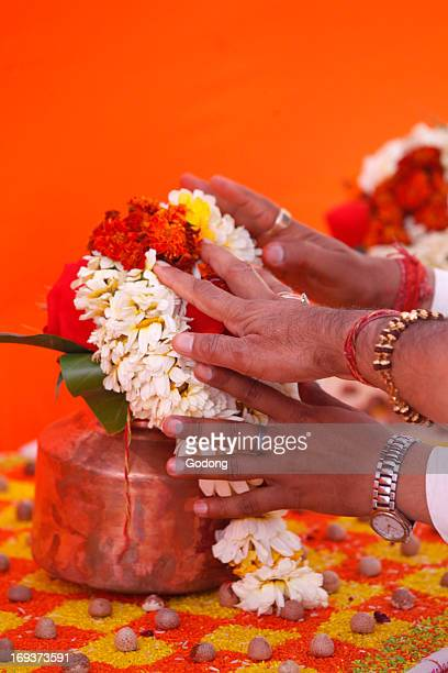 Puja in a Hindu temple garland offering