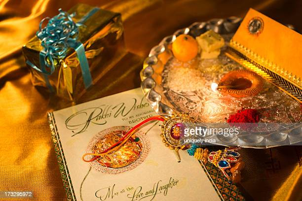 puja thali and greeting card at raksha bandhan - raksha bandhan stock photos and pictures