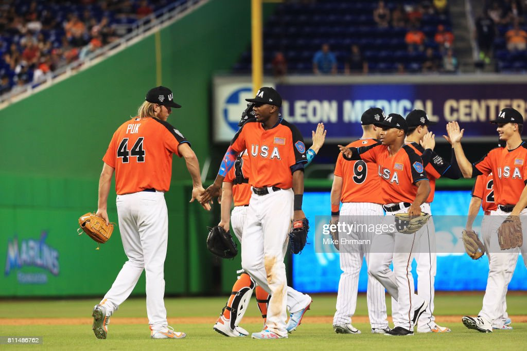 A.J. Puk #44 of the Oakland Athletics and the U.S. Team, Zack Collins #8 of the Chicago White Sox and the U.S. Team celebrate after defeating World Team 7 to 6 during the SiriusXM All-Star Futures Game at Marlins Park on July 9, 2017 in Miami, Florida.
