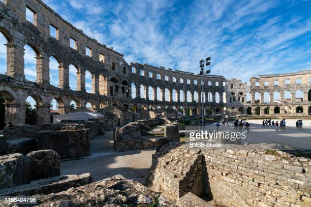 pula arena the roman amphitheatre in croatia - amphitheatre stock pictures, royalty-free photos & images