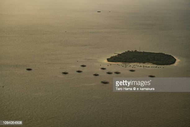 Pulau Damar Besar, Untungjawa Island in Java Sea in Indonesia sunset time aerial view from airplane