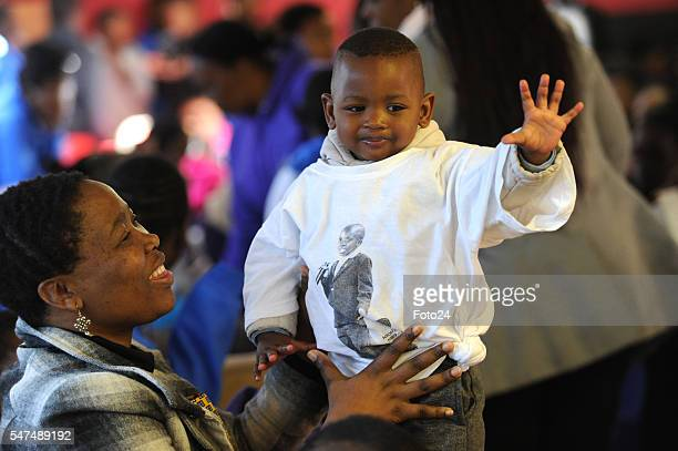 Puleng Makhanya plays with a oneyearold boy during a visit at Nkosis Haven on July 13 2016 in Johannesburg South Africa Deputy President Cyril...