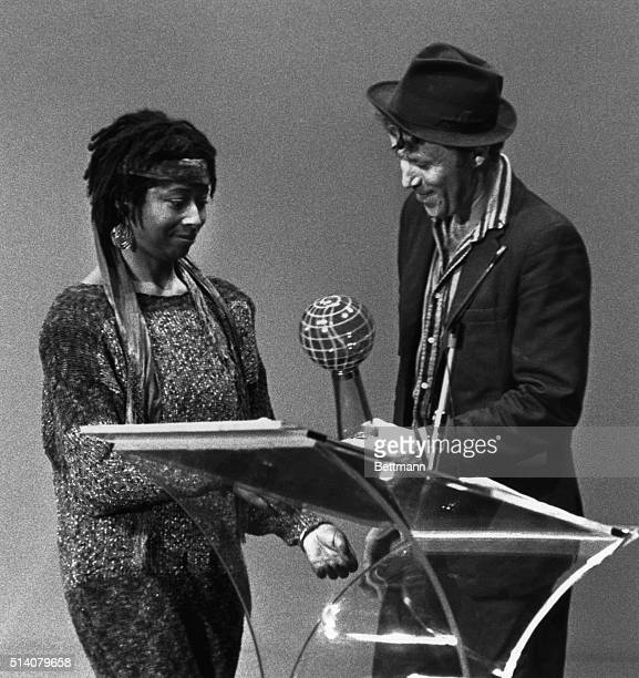 Pulitzer Prize winning author Alice Walker receives Purple Globe award from presenter Tom Waits here of Creative Arts in recognition of Bay Area...