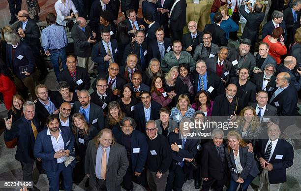 Pulitzer Prize winning photographers including Getty Images photographer John Moore pose for a photo during the Centennial Celebration of Pulitzer...