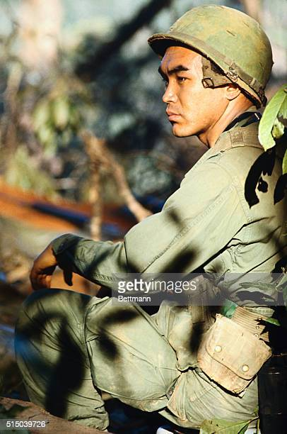 Pulitzer Prizewinning Japanese war photographer Kyoichi Sawada of UPI wearing fatigues on Hill 875 while working with United Press International...