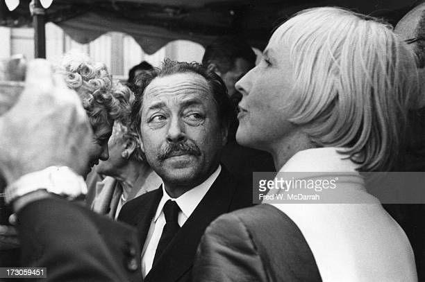 Pulitzer Prize-winning playwright Tennessee Williams listens to poet and philanthropist Ruth Walgreen Stephan at an American Academy of Arts &...