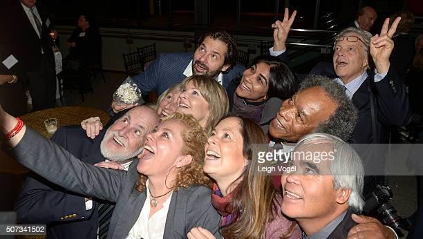 PulitzerPrize winning photographers inlcuding Carol Guzy Rene C Byer Deanne Fitzmaurice Nikki Kahn Scott Applewhite John White and Nick Ut pose for a...