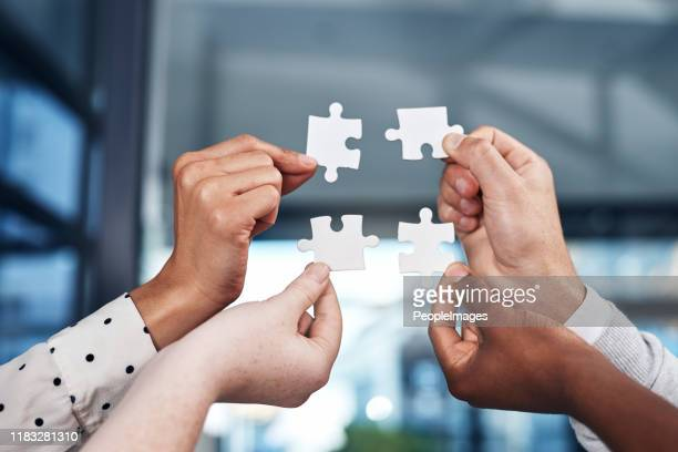 pull together to put it together - employee engagement stock pictures, royalty-free photos & images