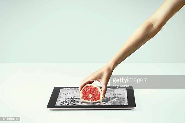 Pull up a pink grapefruit from the digital tablet