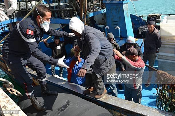 A pulled over boat has been carrying 175 illegal immigrants is seen on the shore after the boat caught and rescued by Tunisian coastal guards in...