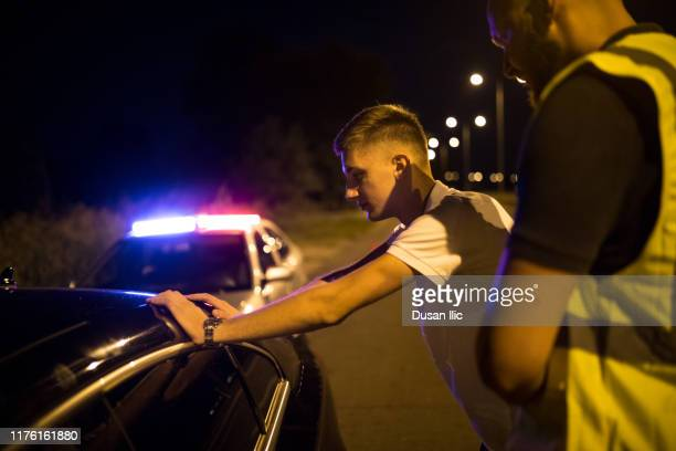 pulled over by the police - chasing stock pictures, royalty-free photos & images