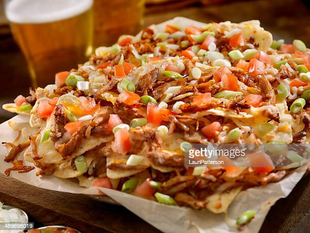 pulled pork nachos - nachos stock pictures, royalty-free photos & images