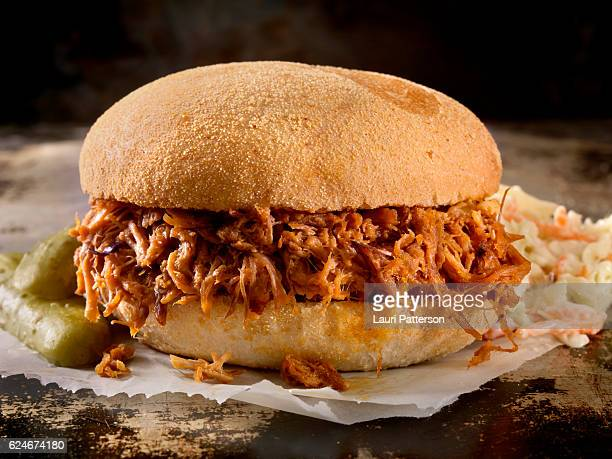 pulled pork sandwich in a savoury bbq sauce with coleslaw - barbeque sauce fotografías e imágenes de stock