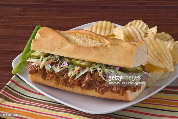 pulled pork sandwich on roll with coleslaw -  firak stock pictures, royalty-free photos & images
