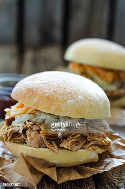 Pulled pork sandwich with carrot and cabbage salad