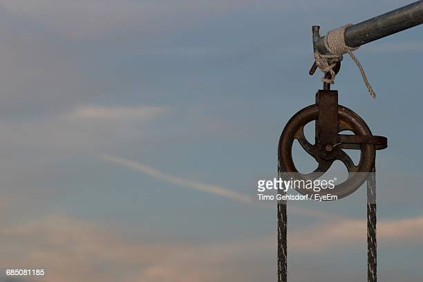 Pulley On Pole Against Sky