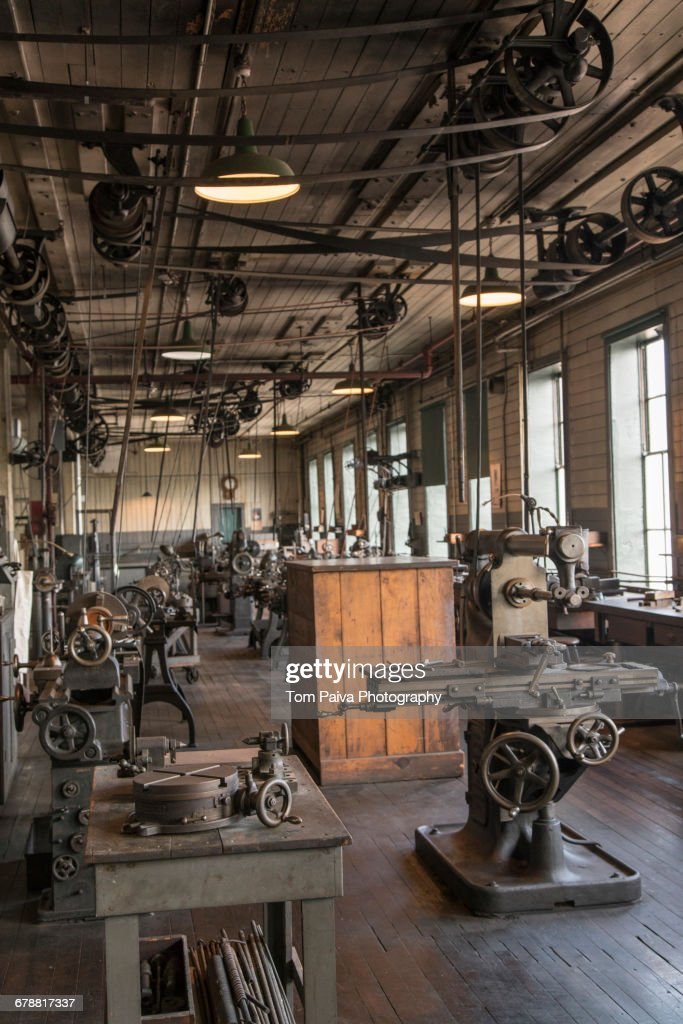 Pulleys And Machinery In Empty Oldfashioned Factory Stock